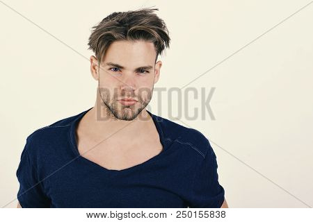 Macho With Confident Face And Bristle. Masculinity And Confidence Concept. Guy In Dark Blue Tshirt A