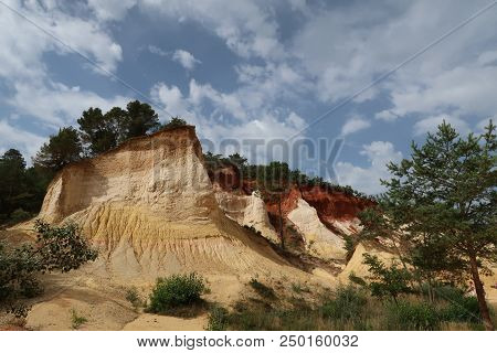 Rustrel, France - July 14, 2018: photography showing a magnificent landscape. The photography was taken from the town of Rustrel while hiking in the provencal colorado in the south of France. poster