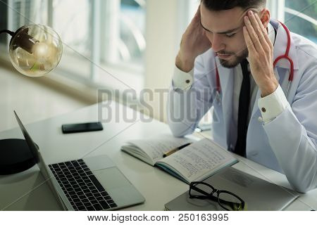 Doctors Are Making Serious Faces And Stressed About Work. The Doctor Is Feeling A Headache At Work A