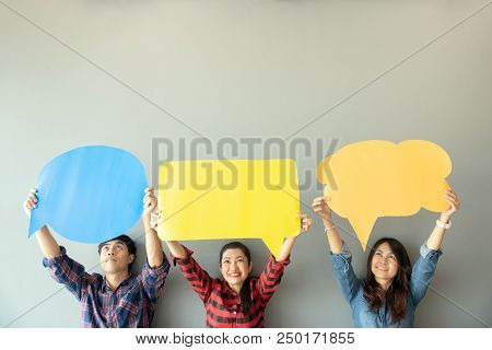 Asian Person Holding Banner (speech And Message Bubble).beautiful Young Female And Male Wearing Fash