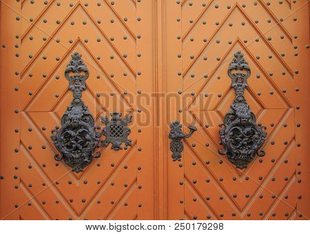 Old Wooden Doors With Beautiful Metal Forging. Vintage, Ornamental Wooden Door Background. Beautiful