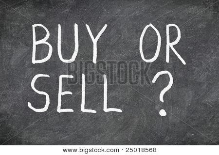 Buy or sell question on blackboard. Buying or selling question mark. Finance, economy, stock or real estate concept - time to buy or sell