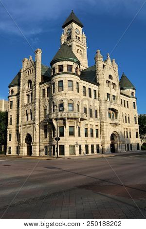 July 15, 2018 In Wichita, Ks:  Vintage Stone Victorian Building Built In 1888 With A Clock Tower Whi