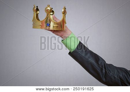 Hand Wearing Crown On Copy Space For Winner Face Isolated. Award Ceremony Of Winner.