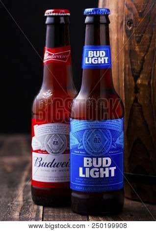 London, Uk - April 27, 2018: Glass Bottle Of Bud Light And Budweiser Original Beer Next To Old Woode