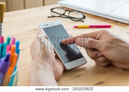 Businessman Touch Screen Of Smartphone Close Up