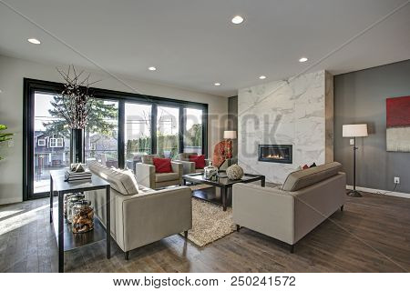Spacious Living Room Interior In Neutral Tones.