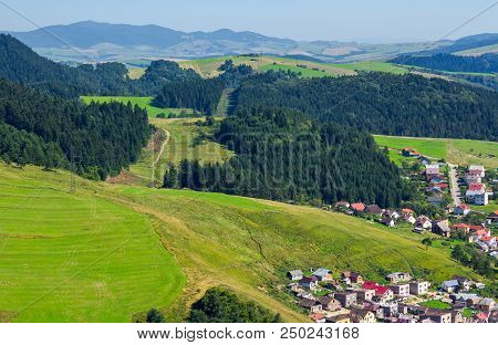 Outskirts Of Old Town Stara Lubovna. Bright Sunny Day With Mountains In The Distance. View From The