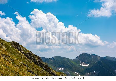 Beautiful Cloudscape Over The Fagaras Mountains. Bright Sunny Day In Romania. Beautiful Nature Backg