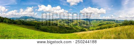 Panorama Of Mountainous Countryside. Lovely Countryside Scenery In Early Autumn With Grassy Field On