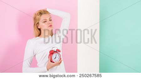 Lack of sleep bad for your health. Oversleeping side effects is too much sleep harmful. Girl drowsy face just woke up holds alarm clock pink background. Bad sleep habits and effects on your life. poster