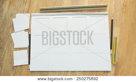 White paper frame 200gsm texture and cutting rectangular has stationary are pencil, cutter ruler, scale ruler on the desk, Art work, homework, job concept. poster