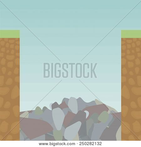Two Edge Cut Edge Of A Soil Slice From Within Under Grass, An Orange Earth With Rounded Stones And A