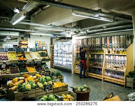 Paris, France - Oct 13, 2017: Worker Inside Interior Store Arranging Cereals On Shelves Diverse Bio