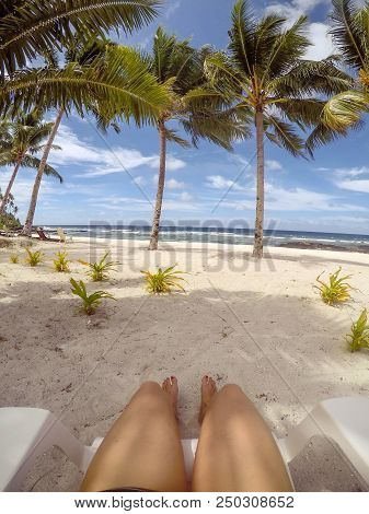 Relaxation On Vacation Pov: Piont Of View From Sun Lounger Under Palm Trees On Tropical Beach On Vac