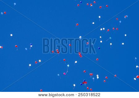 Many helium party balloons floating skyward white poster