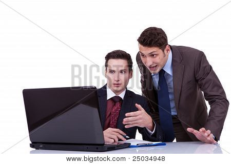 two shocked business men looking at something on their computer poster