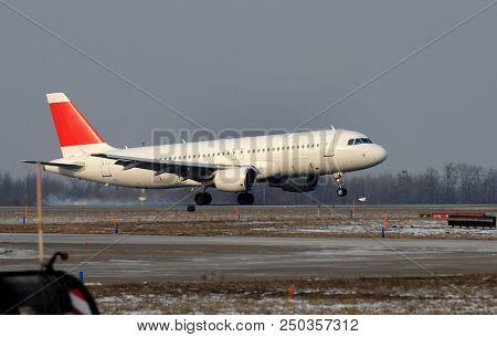 Passenger Jet Moving On The Runaway Tarmac