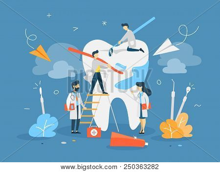Group Of Small Dentists In Uniform Treat Giant Tooth Using Medical Equipment. Idea Of Dental Care. F