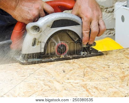 Close Up Electric Saw To Sawing Wood Board.