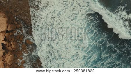 Aerial Photography. Sea Landscape And Blue Raging Waves. Rocky Coast.
