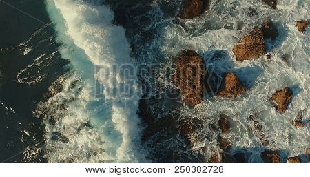Aerial Photography. View From Above.  Seascape. A Huge Wave Is Breaking Against The Rocks.foam Waves