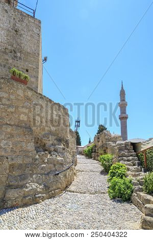 Minaret Of Suleiman's Mosque View From Under Medieval Clock Tower In Rhodes, Dodecanese, Greece