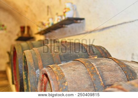 Wine Cellar With Wooden Barrels. Wines Fermented In Classic Wooden Barrels. Typical Moravian Wine Ce