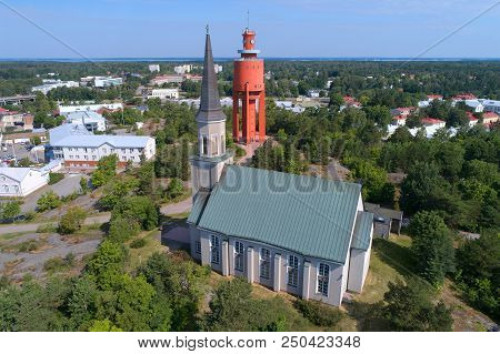 The Lutheran Church and the old water tower in the July day (aerial survey). Hanko, Finland poster