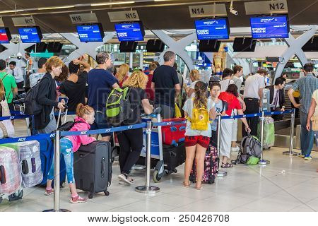 Bangkok, Thailand - 21 July 2018 - Tourists And Travellers Wait In Line To Check Their Luggages In A