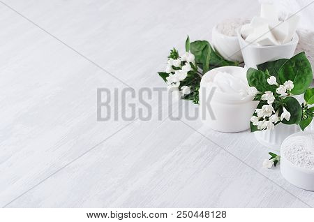 Soft Pure White Delicate Cosmetics Set Of Cream, Salt, Clay Decorated White Flowers, Green Leaves On