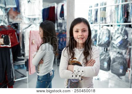 Cute Little Girl On Shopping. Portrait Of A Kid With Shopping Bags. Child In Dress, Sunglasses And S