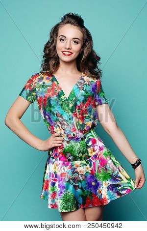Beautiful And Fashionable Woman Holding Dress And Smiling At Camera. Portrait Of Sweet, Pretty Brune