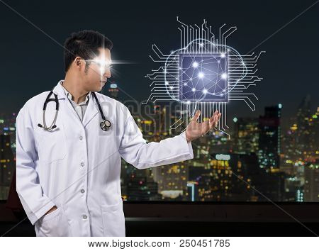 Asian Doctor With The Stethoscope Equipment Hand Holding The Artificial Intelligence Of Brain Techno