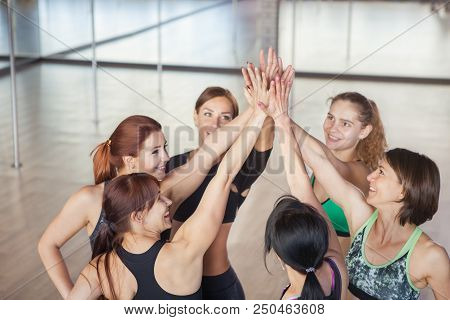 Fitness, Sport, Exercising, Gesture And People Concept - Group Of Happy Friends Making High Five In