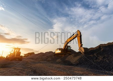 Backhoe Used In Construction, Big Excavator On New Construction Site, In The Background The Blue Sky