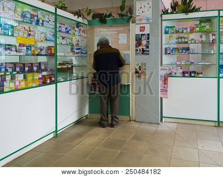 Gryazi, Russia - July 5. 2018. Pensioner Buys Medicines In A Pharmacy In Department Of Preferential
