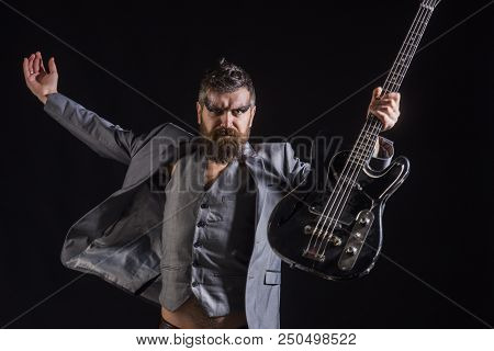Man Guitarist. Man Hold Electric Guitar. Bearded Man With Guitar. Man On Rock Concert. Play The Musi