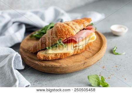Sandwich With Ham And Cheese On Croissant Bun. Tasty Croissant Sandwich. Selective Focus