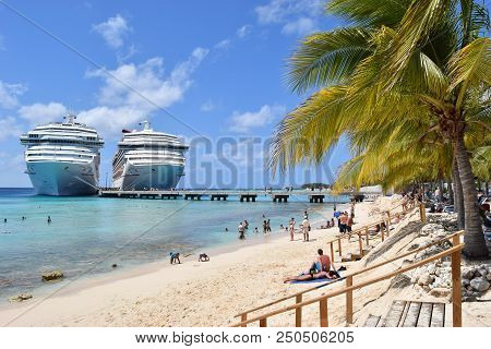 Grand Turk, Turks And Caicos Islands - April 03 2014: Carnival Liberty And Victory Cruise Ships Side