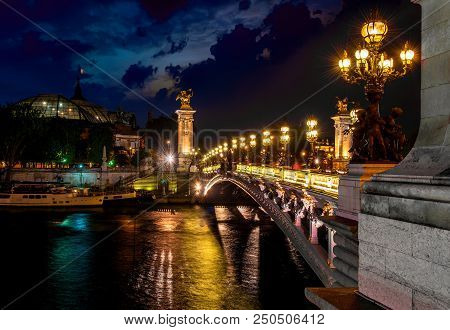 Night Over Bridge Alexandre Iii With The View On Grand Palais In Paris, France