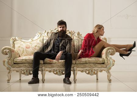 Luxury Concept. Luxury Couple Rest On Sofa. Luxury Life Of Sexy Business Woman And Bearded Man. Coup