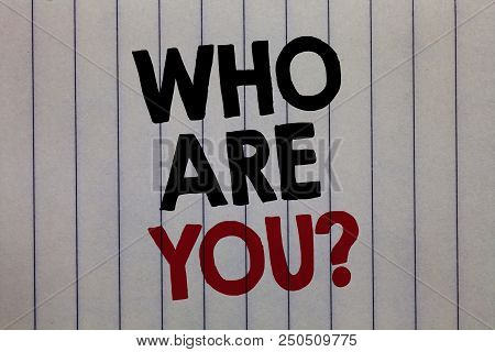 Handwriting text writing Who Are You question. Concept meaning Identify yourself description personal characteristics white vertical paper written three words with black and red color poster