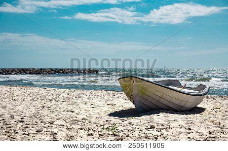 Boat On The Sandy Sunny Beach. Stock Photo.