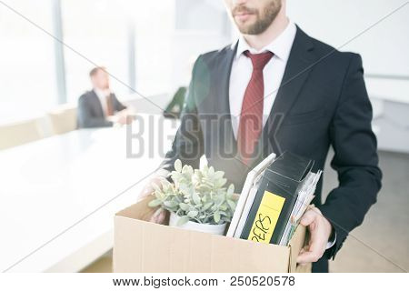Mid Section Portrait Of Handsome Businessman Holding Box Of Personal Belongings  Leaving Office Afte
