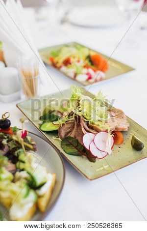 Canapes In Plate On Festive Table, Stock Photo Image