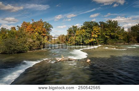 The Niagara River Above Horseshoe Falls With Forest In Fall Colours