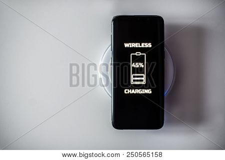 Black Touchscreen Smartphone Wireless Charging On Induction Charger