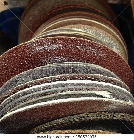 Row Of Old Used Sanding Discs In A Tradesman's Workshop