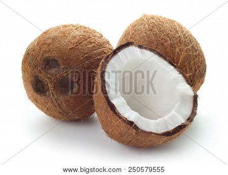 Close-up View Of Three Coconuts Isolated On White Background